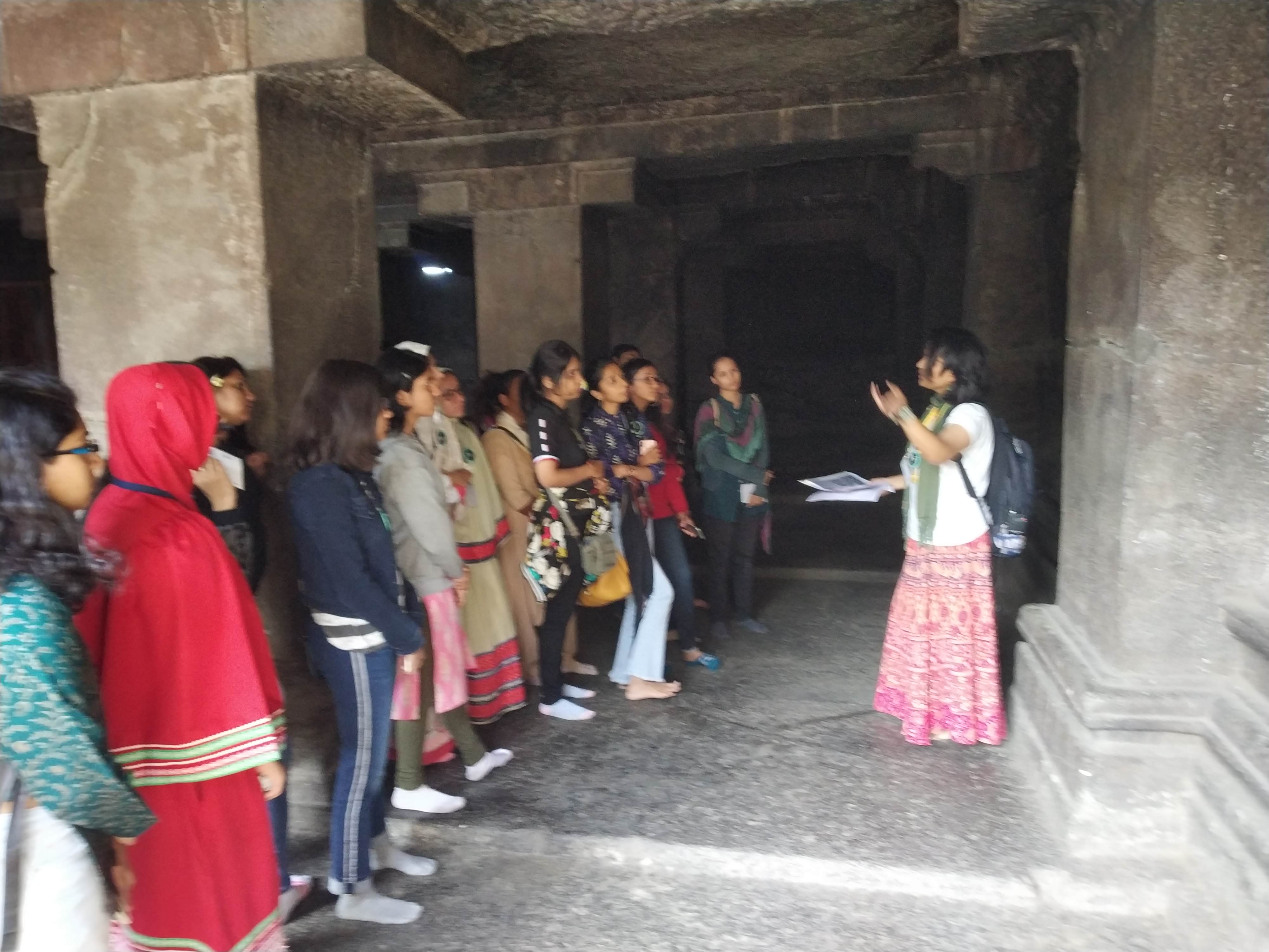 Heritage Walk Pataleshwar Caves Sculpture on the Wall being explained Dept. of History