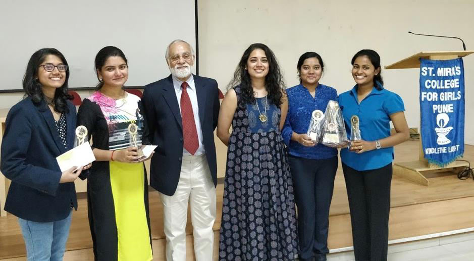 The Runner – Up Team and the 2<sup>nd</sup> Best Speaker prize winners, Sharon Chandekar and 														Harshika Shirgaokar from Ness Wadia College along with the judges, Mr. Suraj Sriram 														and Ms. Priyanka Menon, and the Best Team winners Ayushi Halder and Swathi Satish 														from St. Mira's College.