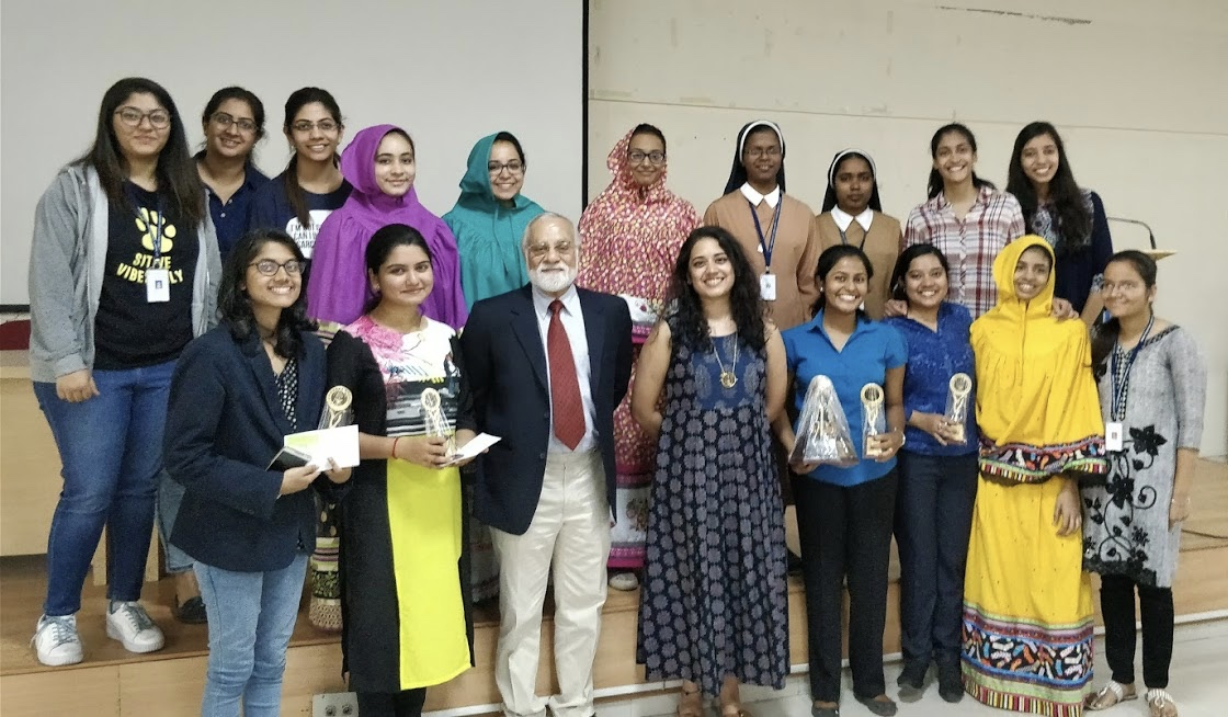 The judges, Mr. Suraj Sriram and Ms. Priyanka Menon, and the winners with the Debate 														Organizing Committee.