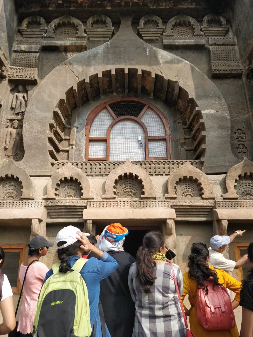 Students engrossed at Ajanta Cave