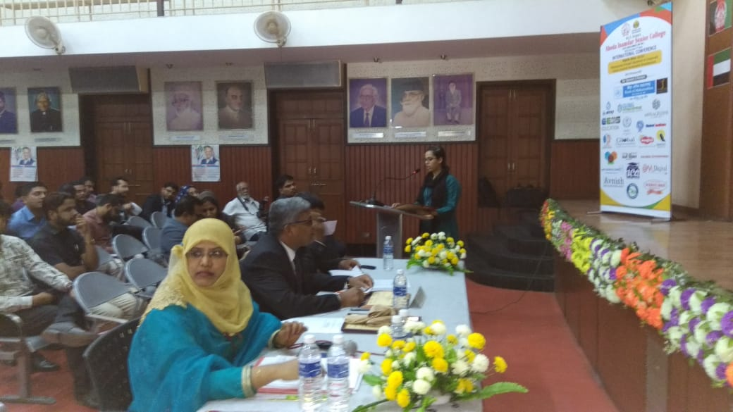 Student Presenting Paper at an International Conference  held at Abeda Inamdar College.